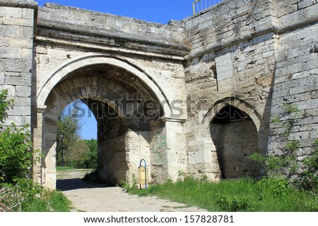 An old fortified wall with arc and entrance. Medieval fortress Baba Vida entrance and wall in Vidin, northwestern Bulgaria. The fortress is one of the biggest landmarks in the region. - stock photo