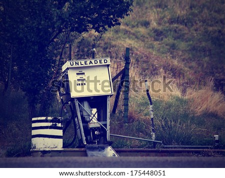an old gas pump done with a retro vintage instagram filter - stock photo