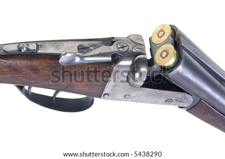 An old 16-gauge shotgun with two cartridges inserted into the chambers Clipping Path Included! - stock photo