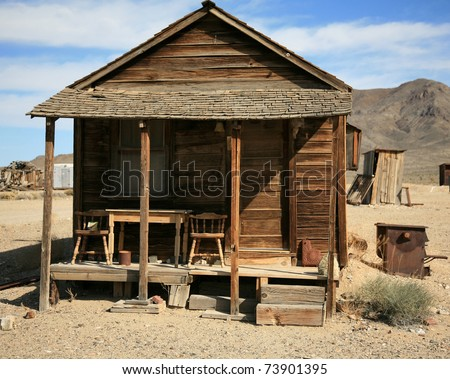 an old gold miners shack in a real ghost town from the 1800's in the wild west of california or nevada - stock photo