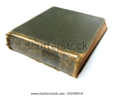 an old green photo or stamp album with torn cover and yellowing pages on a white background