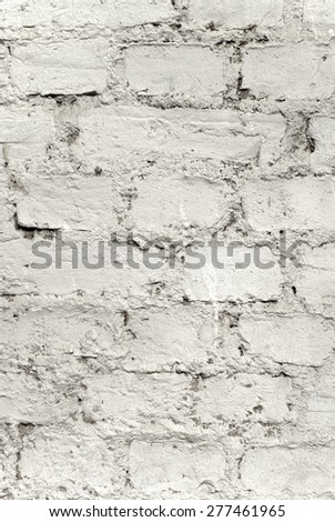 An Old Grunge White Painted Brick Wall  - stock photo