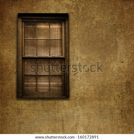 An old grungy window with blinds and cracked stone wall. - stock photo