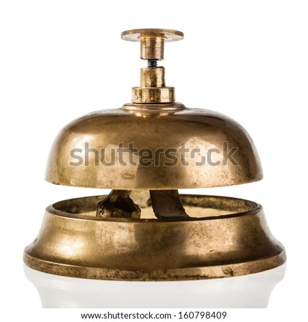 an old hotel bell isolated over a white background - stock photo