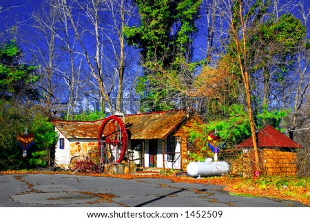 An old house, with a dreamy, unnatural fairy tale look; strong colors resemble a chromolithograph. - stock photo