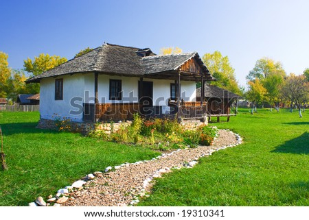 An old house with a long cobble ride in front from Romania - stock photo