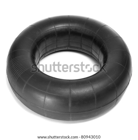 an old inner tube on a white background - stock photo