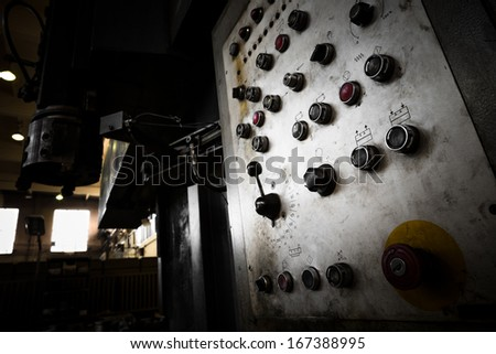 an old instrument control panel, in electronics factory - stock photo