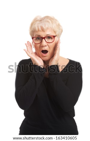 An old lady expresses shock/ surprise. Isolated on white.  - stock photo