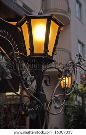 An old lantern in front of hotel restaurant. - stock photo