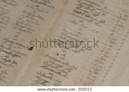 An old ledger from a long time ago, with a fairly shallow depth of field. - stock photo