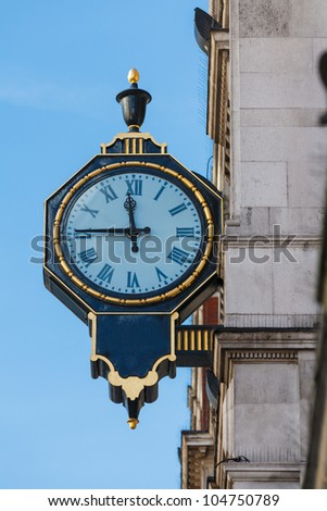 An old London street clock, London, UK - stock photo