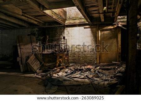 An old machine in an abandoned factory. - stock photo