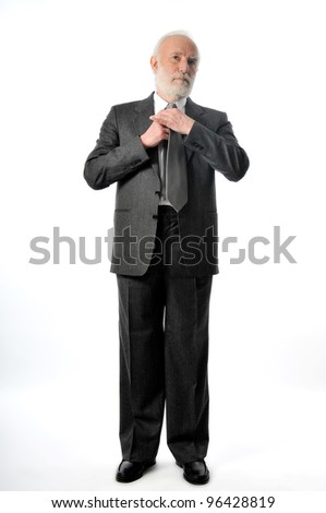 an old man fixes tie - stock photo