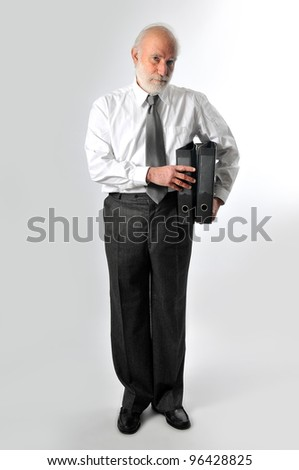 an old man holds two folders - stock photo