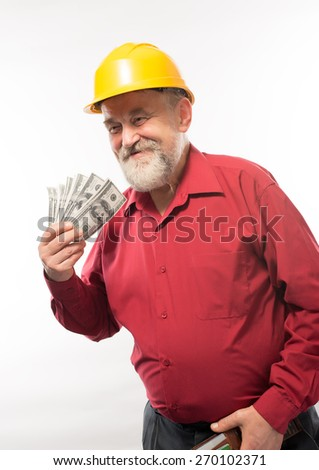 an old man in a helmet with dollars - stock photo