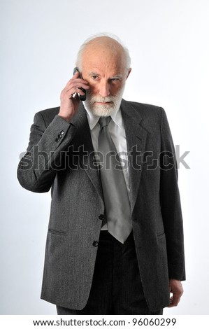 an old man speaking in his phone