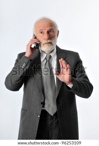 an old man talking his phone - stock photo