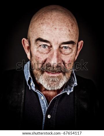An old man with a grey beard - stock photo