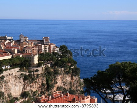 An old mansion on the hill overlooking the Mediterranean coastline of Monte Carlo in Monaco. - stock photo