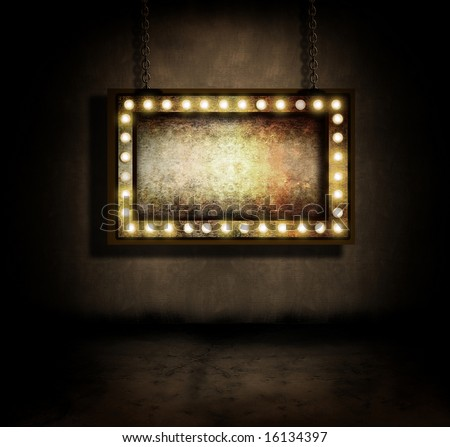 An old marquee sign hanging in a dark room - stock photo