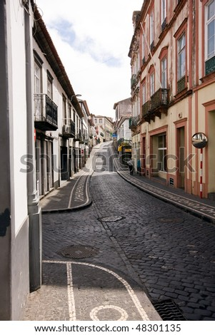 an Old medieval looking european street - stock photo