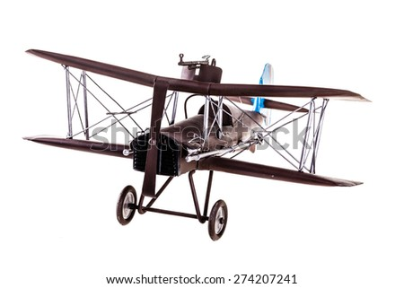 an old metal airplane toy model isolated over a white background - stock photo