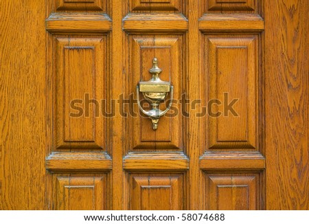 an old metal door handle knocker - stock photo