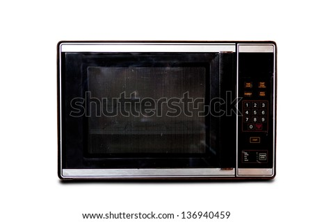 An old microwave isolated on white - stock photo