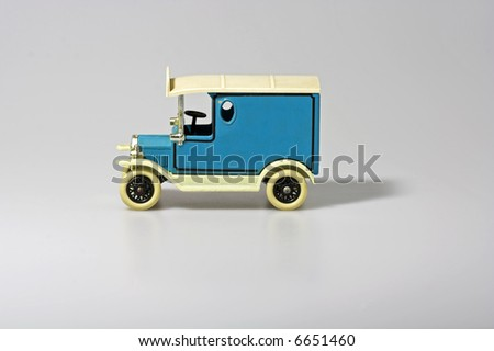 An old miniature of an antique truck (toy) - stock photo