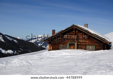 An old mountain shelter house covered with lots of snow - stock photo
