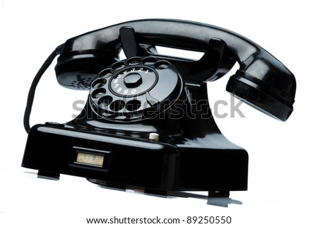 an old, old land line telephone. phone on a white background. - stock photo