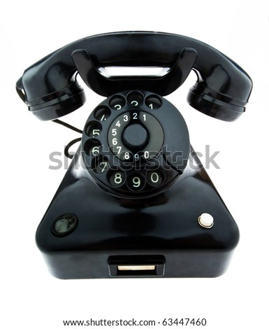 An old, old landline telephone. Phone on a white background.