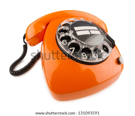 an old orange phone with rotary dial