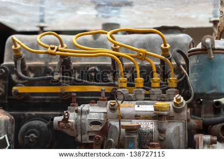an old outdated diesel engine - stock photo