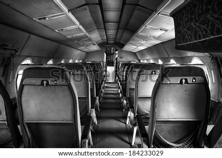 an old outdated passenger air inside, detail - stock photo