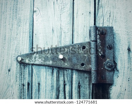 An old patterned hinge - stock photo