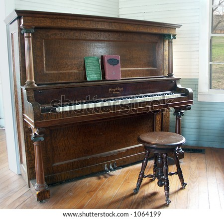 An Old Piano in a Country Church - stock photo
