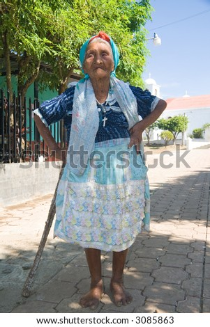 An old Pipil woman coming out of church