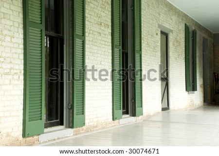 An old porch with windows at Grassmere in Nashville TN built in the 1800's, horizontal with copy space - stock photo