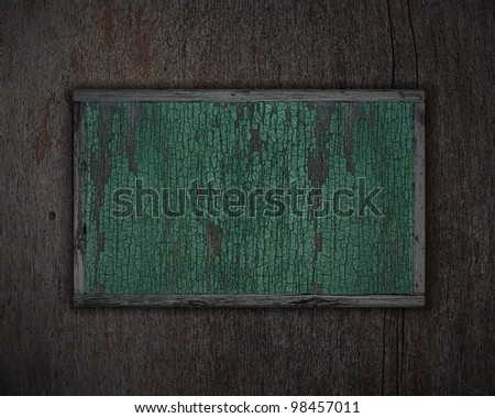 an old poster on wooden background - stock photo