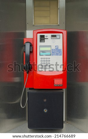 An old public telephone in red. Communications and technology concept - stock photo