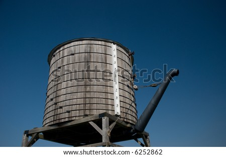 An old railroad water filling station - stock photo