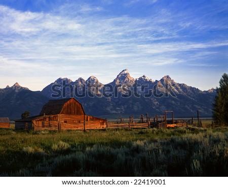 An old ranch and the Teton Mountain Range in Grand Teton National Park, Wyoming. - stock photo