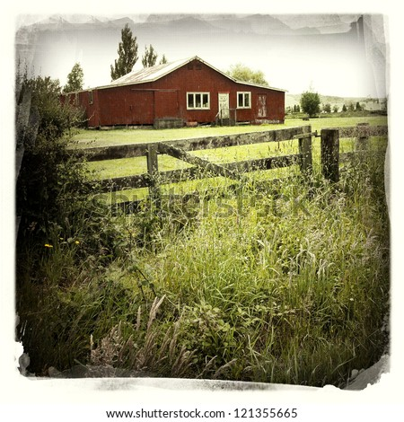 An old red barn in rural scene - stock photo