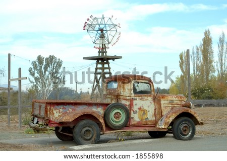 An old red truck shot from the side. - stock photo
