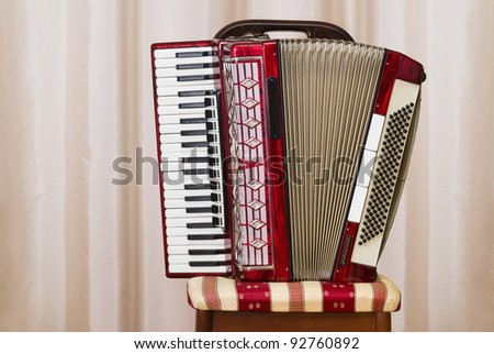 An old retro accordion is waiting for the player. - stock photo