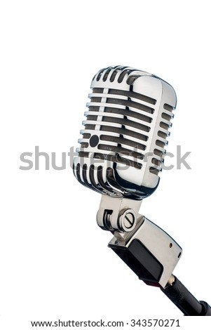 an old retro microphone in front of a white background. - stock photo