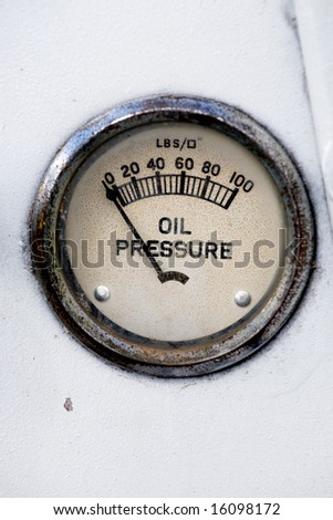 An old retro steampunk style oil pressure gauge - stock photo