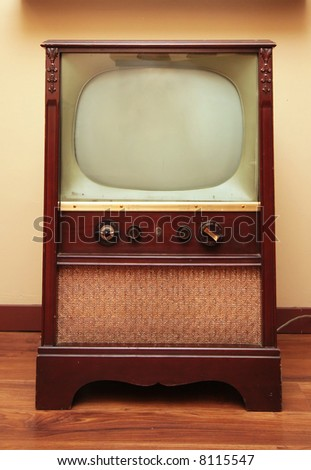 An old retro television with a small screen and a big speaker. - stock photo
